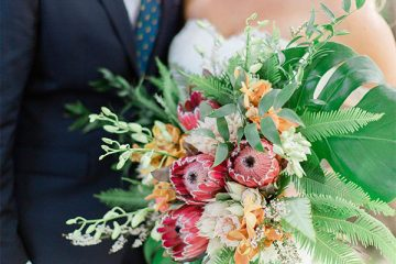 Bride and groom with gorgeous bouquet